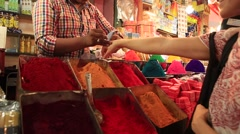 HOLI POWDER AT THE MARKET IN MYSORE, INDIA Stock Footage