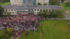 Inner yard of school is full of kids and parents at September, 1. Russia Stock Footage