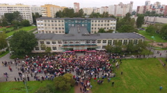 Crowd of schoolkids with parents are on the inner yard of school at September, 1 Stock Footage