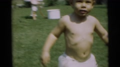1967: adventurous baby has no shyness for the camera unlike his sibling  Stock Footage