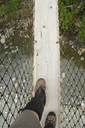 Crossing the Logan Creek Suspension Bridge, West Coast Trail, Pacific Rim Stock Photos