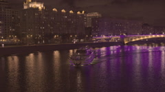Tourist boat illuminated in Moscow river at night Stock Footage