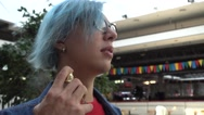 Transgender Gay with blue Hair sprinkles Perfume on Neck Stock Footage