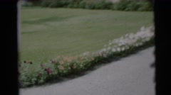 1954: toddler bounces excitedly down a driveway PENNINGTON, NEW JERSEY Stock Footage