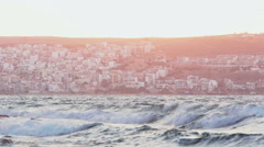 City and harbor in the pink sunset light Stock Footage