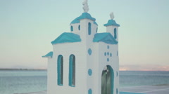 Miniature church model on a sea side on the sunset time in Greece Stock Footage