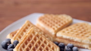 Freshly baked waffles and fruit for breakfast Stock Footage