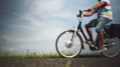 Close up view on the bicycle wheels passing by on the bike path Stock Footage