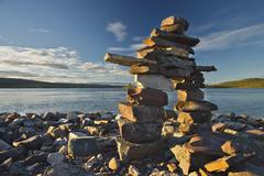 Inukshuk along the shores Of Great Slave Lake, Northwest Territories, Canada. Stock Photos