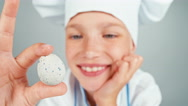 Close up portrait chef cook girl holding small quail eggs and smiling at camera Stock Footage