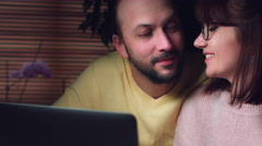 4K Business Shot of a Couple Working on Computer and Kissing Stock Footage