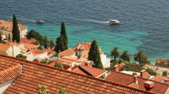 View on the sea and red roofs of Dubrovnik town in sunny day Stock Footage