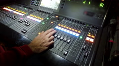 Professional audio mixing console with faders and adjusting knobs - radio / T Stock Footage