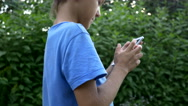 Boy goes and uses the phone, Sun rays Stock Footage