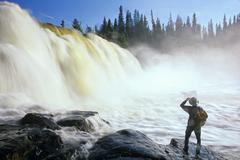 Hiker at Pisew Falls, Pisew Falls Provincial Park, Manitoba, Canada. Stock Photos