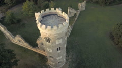 Pan around tower of medieval ancient castle ruins, aerial view Stock Footage