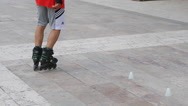 Active young men rollerblading on the promenade in front of the beach. Stock Footage