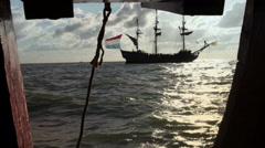Old wooden tall ship viewed from gun port of another ancient ship Stock Footage