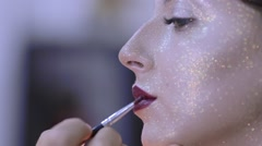 Make-up artist doing make-up fashion Stock Footage