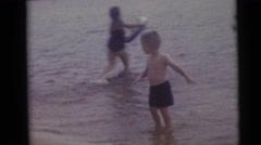 1967: young children splashing in lake near tubers CAMDEN, NEW JERSEY Stock Footage
