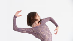 Young Woman in a Purple Dress Doing Modern Dance on a White Background Stock Footage