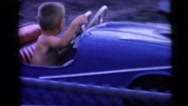 1967: young boy enjoys a car ride at the miniature golf park CAMDEN, NEW JERSEY Stock Footage