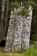 Kiusta Village, triple mortuary totem poles of Chief Edenshaw near Langara Stock Photos