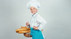 Portrait baker girl child holds basket with bread baguette isolated on white Stock Footage