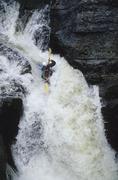 Kayaker paddling waterfall on McCloud River, near Jasper National Park, Alberta, Stock Photos