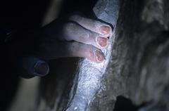 Hand gripping rock at Cathedral Boulders, British Columbia, Canada. Stock Photos