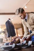 Businessman browsing socks in menswear shop Stock Photos