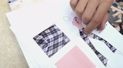Close-up - Fashion Designer shows his Sketches a new Collection of Clothes Stock Footage