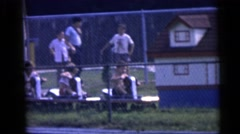 1967: youth at amusement park peddle a vehicle on a track for entertainment Stock Footage