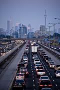 Rush-hour traffic on QEW (Queen Elizabeth Way) and Toronto city skyline, Stock Photos