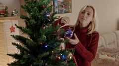 Mother hanging on the Christmas tree new year toy Stock Footage
