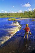 Hiker at Rainbow Falls, Whiteshell Provincial Park, Manitoba, Canada. Stock Photos