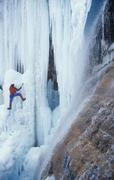 Man ice climbing in Kananaskis Country, Alberta, Canada. Stock Photos