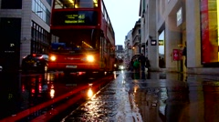 Red London bus passes in the rain Stock Footage