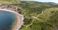 Aerial view past steep cliffs Stock Footage