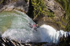 A kayaker running the 60 foot Sutherland Falls, Revelstoke, British Columbia, Stock Photos