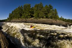 A kayaker playboating in the Ottawa River, Ontario, Canada Stock Photos