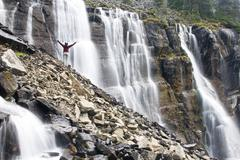 A female hiker at Seven Veils Falls near Lake Ohara in Yoho National Park, Stock Photos