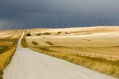 Stormy skies and windmills near Pincher Creek, Alberta, Canada. Stock Photos