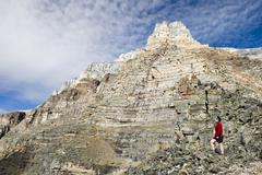 A female hiker looks out from Sentinel Pass near Moraine Lake in Banff National Stock Photos