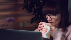 4K Corporate Shot of a Business Woman Working on Computer and Drinking tea Stock Footage