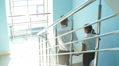 Confident business partners in office building. view from above Stock Footage