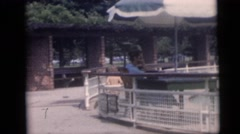 1967: child runs through the swimming pool CAMDEN, NEW JERSEY Stock Footage