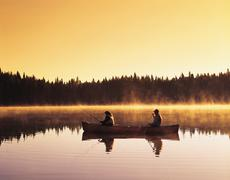 Couple canoeing and fishing, Perch Lake, Duck Mountain Provincial Park, Kuvituskuvat
