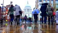People walking in the rain with umbrellas Stock Footage