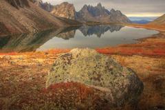 Tombstone Mountain reflected into Talus Lake, Tombstone Territorial Park, Yukon, Stock Photos